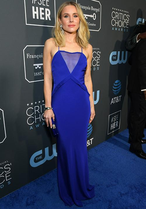 In one of the few actresses to wear a bold splash of colour. Kristen Bell is rating high on our best dressed list in this blue Cushnie dress. *(Image: Getty)*