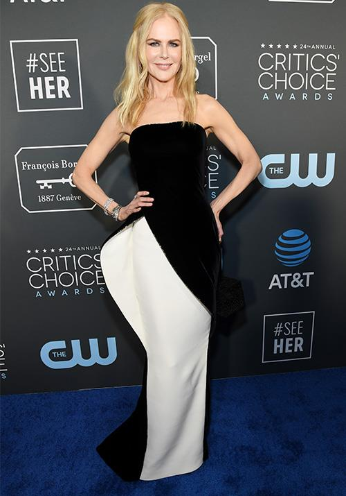 Nicole Kidman's striking asymmetrical Armani Prive gown is a front runner for best dressed. *(Image: Getty)*