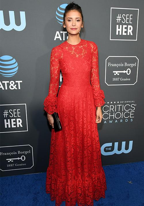 *Vampire Diaries* star Nina Dobrev channels vamp-chic in this trademark Valentino red ensemble. *(Image: Getty)*