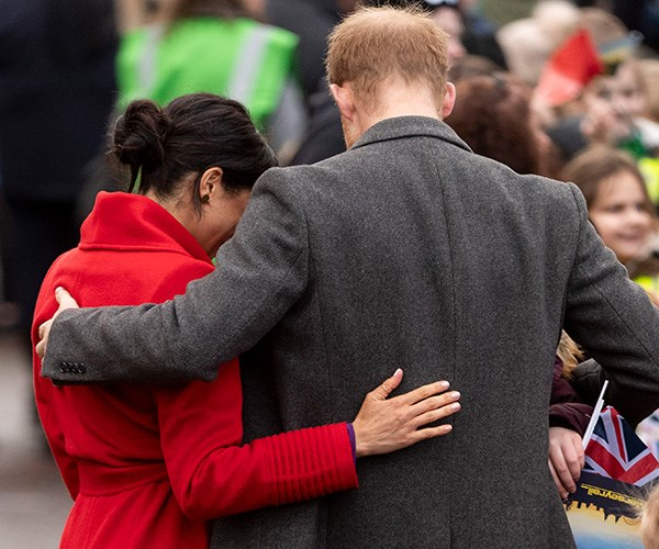 The Duke and Duchess share a tender moment as they greet the crowds. *(Image: Getty Images)*
