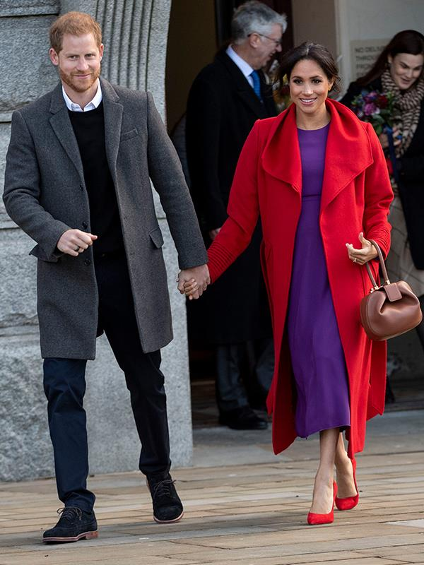 The pregnant 37-year-old brought a right royal splash of colour as she and Prince Harry stepped out for their first joint royal engagement of 2019 in Birkinhead. *(Image: Getty Images)*
