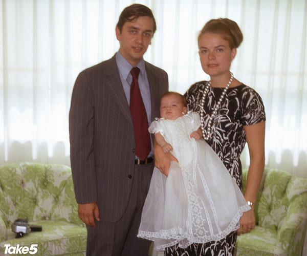 My dad and mum, with me as a baby