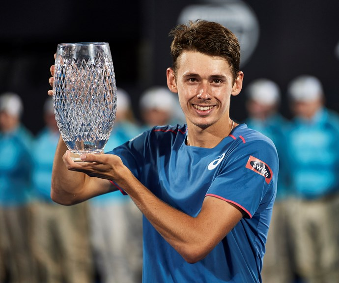 Alex holding his Sydney International winner's trophy. *(Image: Getty)*
