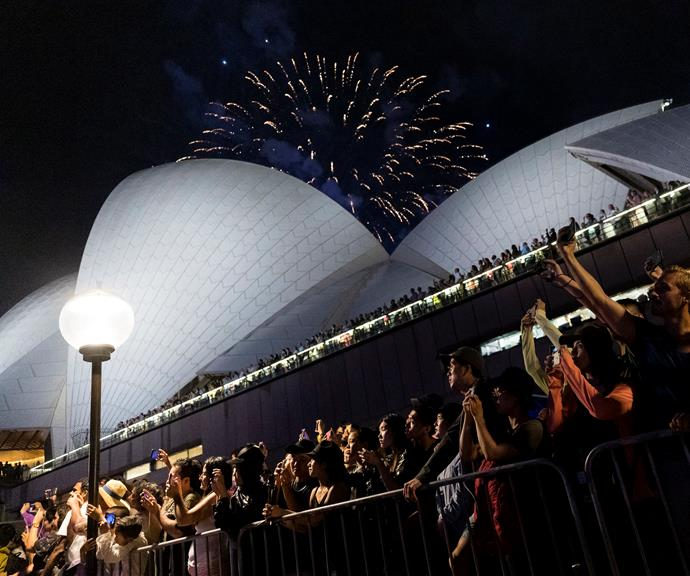 **The Sydney Opera House forecourt** will give you a front row seat to the stunning fireworks over Sydney Harbour. Nab a table early at Opera Bar or along the walkway near Circular Quay. *(Image: Getty)*