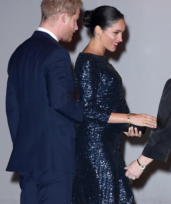 The couple greeted guests before the performance. *(Image: Getty)*