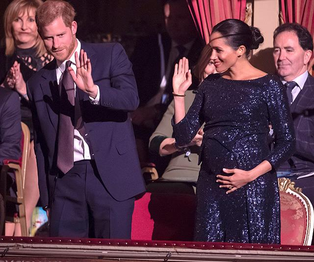 Meghan and Harry waved to ecstatic onlookers before settling in to watch the performance. *(Image: Getty)*