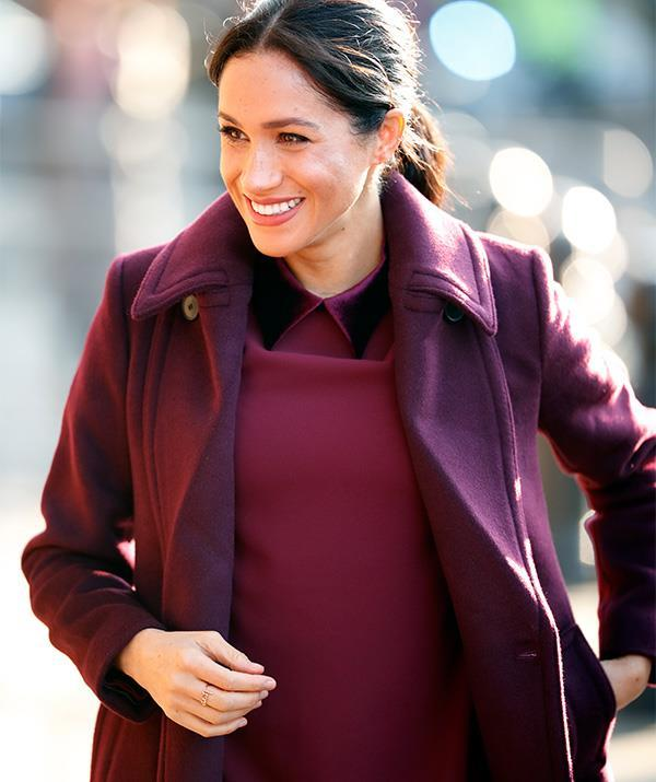 Meghan's sweet addition to this festive outfit was surprisingly affordable. *(Image: Getty)*
