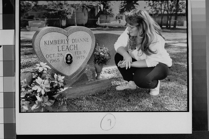 Lisa Williams visiting the grave of her best friend Kimberly Leach, who was a victim of serial killer Ted Bundy. *(Source: Getty)*