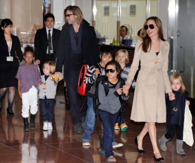 Angelina and Brad with their brood of six in happier times.