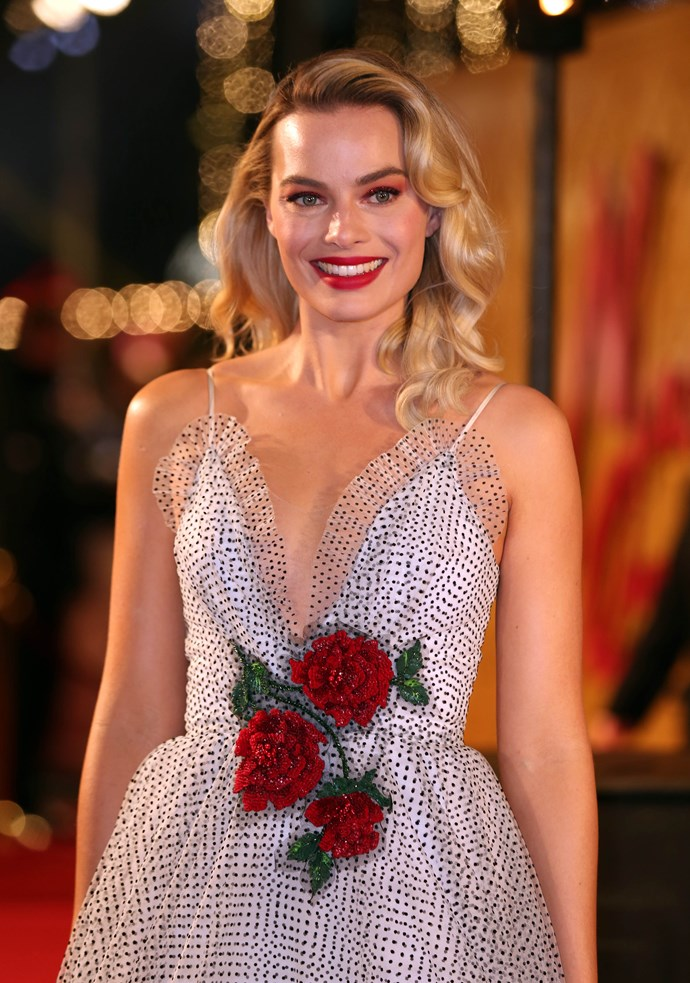 Margot attends the *Mary Queen Of Scots* premiere.
