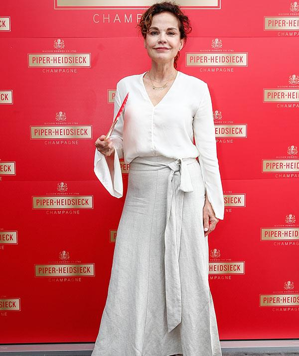 Aussie actress Sigrid Thornton cuts a glamorous figure at the Piper-Heidsieck Australian Open Cocktail Party. *(Image: Getty)*
