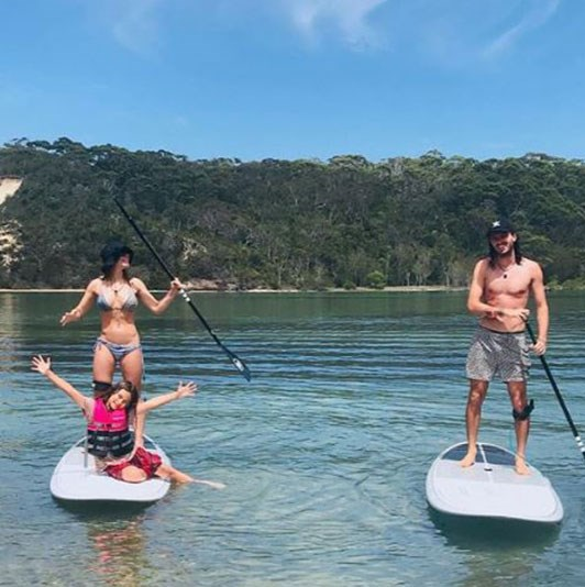 Family fun: Jess, Scout and Jake go paddle-boarding. *(Image: @jay.may.ray Instagram)*