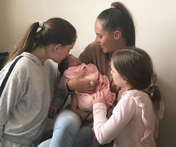 Fev's four girls shortly after Tobi was born. *(Image: Instagram @brendanfevola25)*