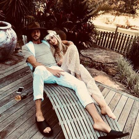 The happy couple: The pair reportedly married over the new year. *(Image: @deltagoodrem Instagram)*