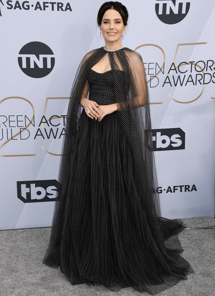 Sophia Bush adds a dramatic twist to her look with a sheer cape.