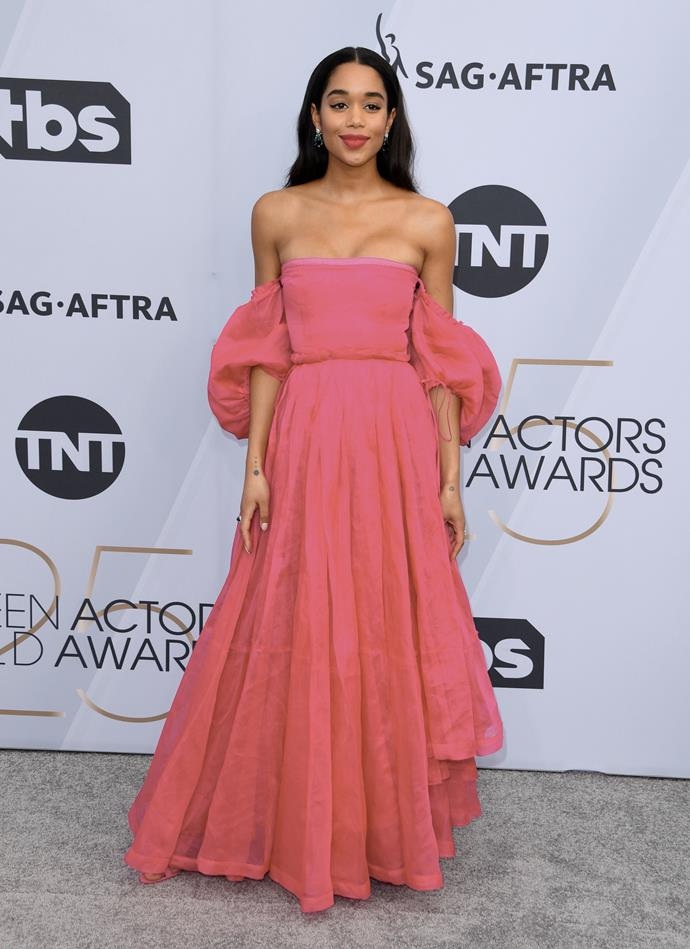 Laura Harrier opts for a strapless fuchsia gown.