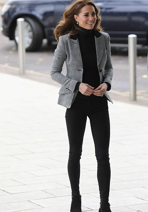 And in another fashion display of dreams, Kate's black skinny jeans struck officewear gold when paired with her Smythe grey blazer and roll neck jumper. *(Image: Getty)*