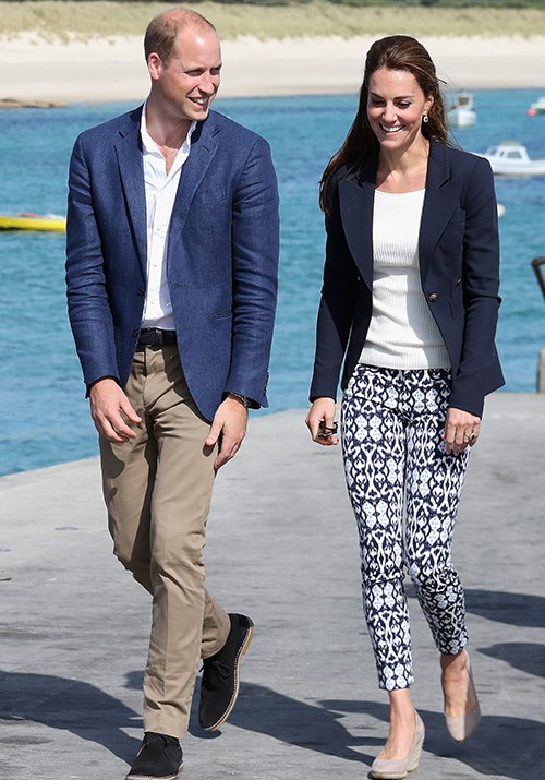 And if you're hoping to cool down the corporate vibe, this Smythe navy blazer paired with printed pants is the definition of smart-casual. *(Image: Getty)*