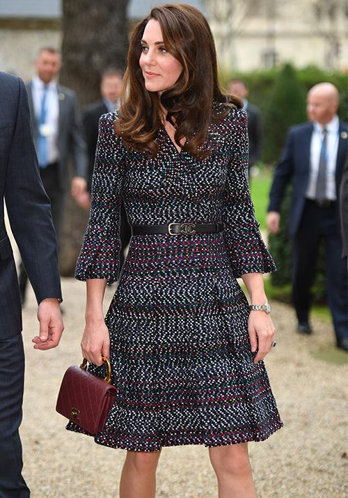A dash of Chanel oozes class, but Kate's overall ensemble here looks like she means business. *(Image: Getty)*