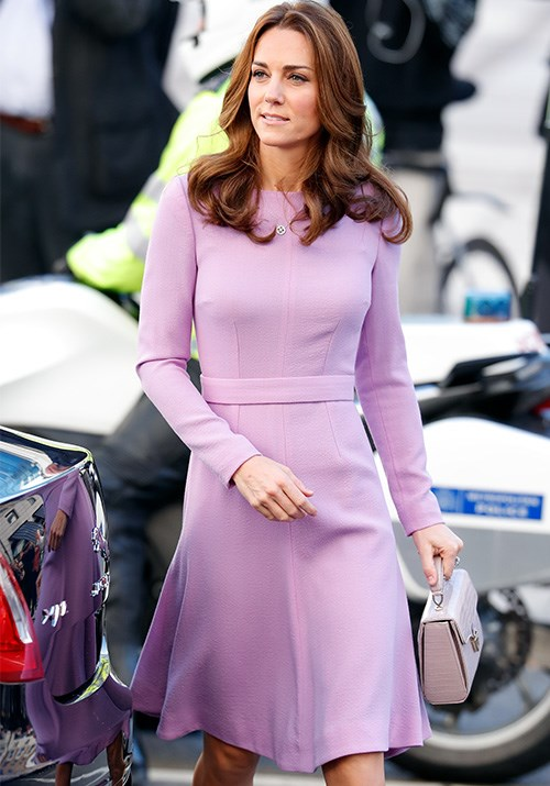Pretty in pink! Kate's gorgeous pastel pink dress by Emilia Wickstead is functional and form flattering - perfect for the office. *(Image: Getty)*