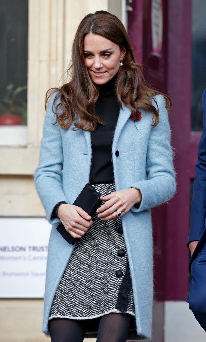 And in another perfect work wear display, Kate's blue peacoat by Mulberry is office-appropriate, and super snug. *(Source: Getty)*