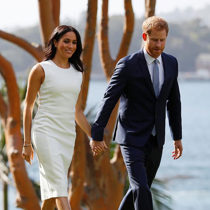 Meghan and Harry announced their pregnancy shortly after touching down in Sydney. *(Image: Getty Images)*