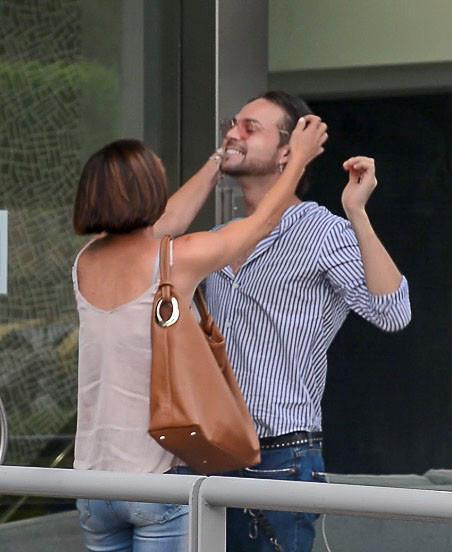 Cass fixes her dance partner's hair outside the KIIS FM studios in Sydney. *(Image: Mega)*