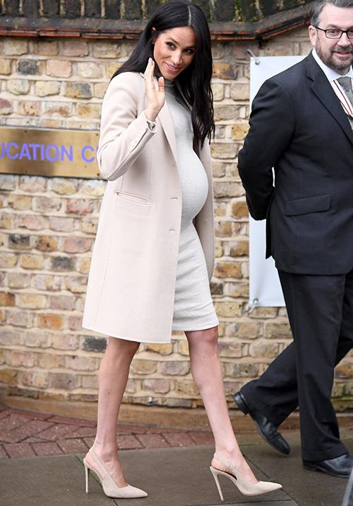 "The Duchess [visited an animal charity](https://www.nowtolove.com.au/royals/british-royal-family/meghan-markle-puppies-mayhew-pet-charity-53590|target=""_blank"") on the rainy London day.  *(Image: Getty Images)*"