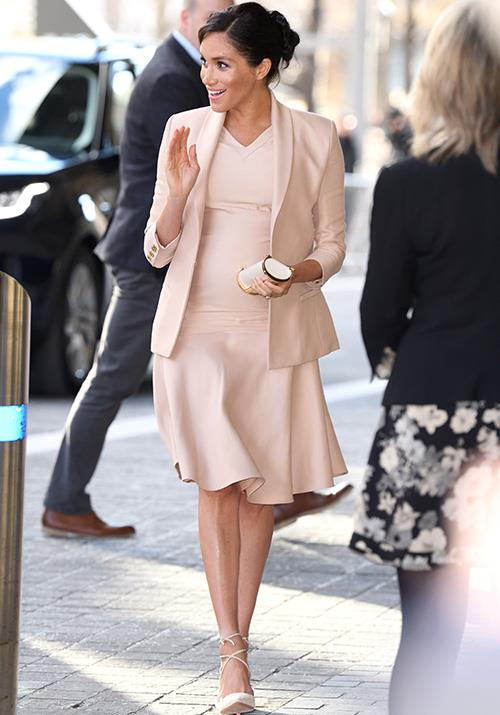 "On January 30, Meghan's baby bump was on full display as she [visited the National Theatre](https://www.nowtolove.com.au/royals/british-royal-family/meghan-markle-beige-dress-53859|target=""_blank"") in London. *(Image: Getty Images)*"