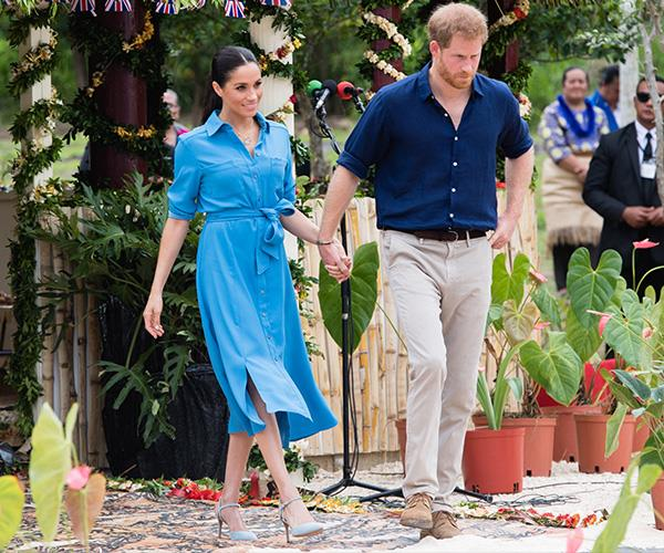 Blue for a boy? Meghan and Harry matched when they visited Tonga shortly after announcing the pregnancy. *(Image: Getty Images)*