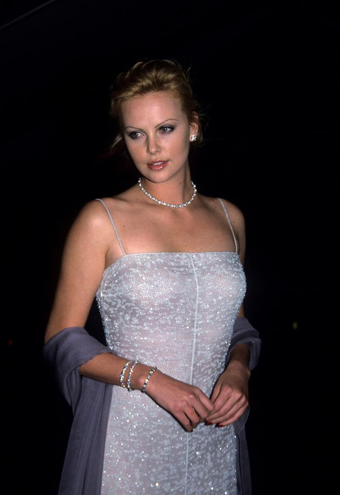 Charlize rocking that evening wear glam look in 1999. *(Source: Getty)*