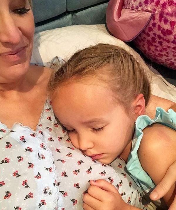 Big day! Trixie looked tuckered out as she and Fifi snuggled together after her first day at school. *(Image: Instagram /@fifi_box)*