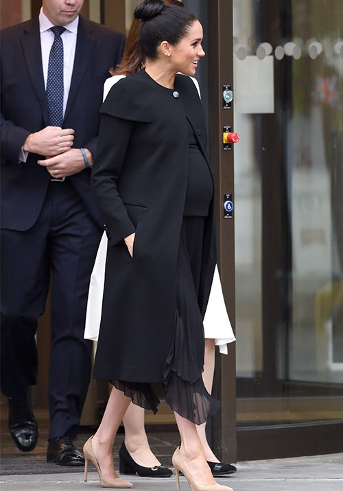 """Visiting the [Association of Commonwealth Universities](https://www.nowtolove.com.au/royals/british-royal-family/meghan-markle-givenchy-coat-53884