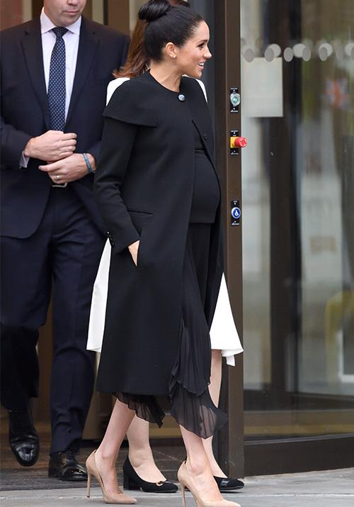"Visiting the [Association of Commonwealth Universities](https://www.nowtolove.com.au/royals/british-royal-family/meghan-markle-givenchy-coat-53884|target=""_blank"") on January 31, the stylish Duchess stepped out in a chic Givenchy caplet coat, which she had worn previously to the [Remembrance Sunday Service](https://www.nowtolove.com.au/preview/royals/british-royal-family/royal-remembrance-day-event-52355
