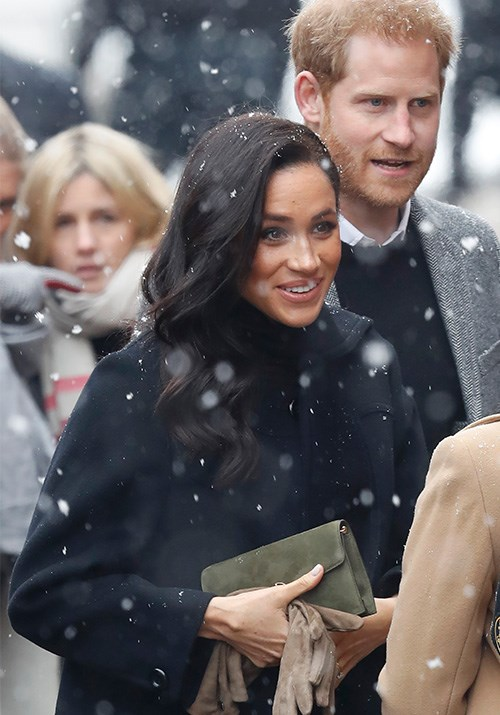 Stepping out in snowy Bristol on Friday, February 1, the royal parents-to-be were well and truly wrapped up warm - but that didn't stop Meghan from looking stylish as ever. *(Image: Getty Images)*