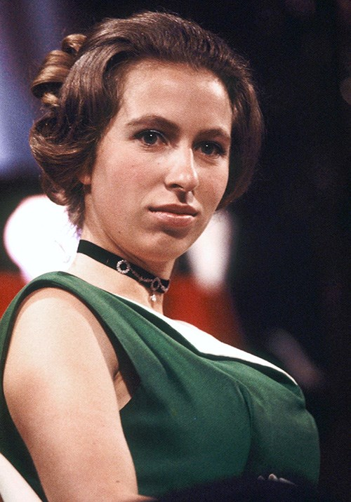 Old Hollywood at its finest! A 21-year-old Princess Anne was the image of elegance in this green and white frock when she attended the British event in 1971. *(Image: Getty)*