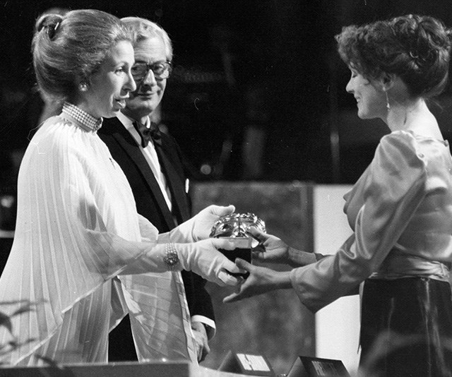 In 1979, Princess Anne, who was in her late twenties at the time, looked chic in a pleated gown and pearl choker necklace. *(Source: Getty)*
