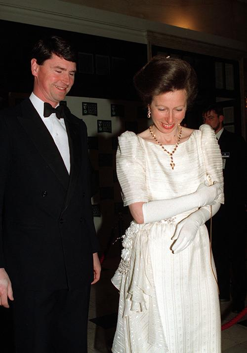 Much like Wills and Kate, Princess Anne has also enjoyed attending the awards event over the years. Pictured here in 1994 with her husband Commander Tim Laurence, the pair looked set for a glam night out.  *(Image: Getty)*