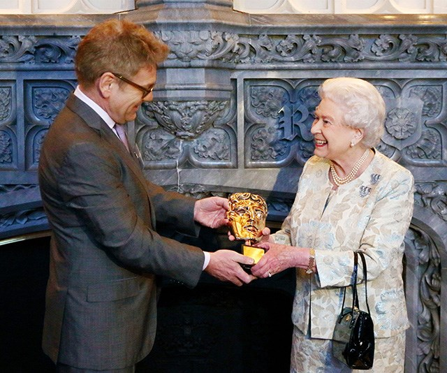 In 2013, the Queen herself was gifted an honorary award by the association for her support from various patronages. The then 87-year-old looked radiant in a muted-toned ensemble.  *(Image: Getty)*
