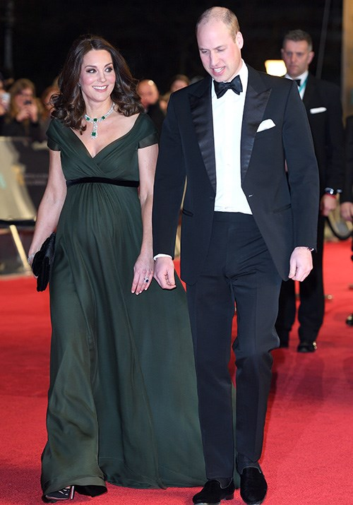 Looking sharp, Prince William and Duchess Catherine were the picture of class as they stepped out at the 2018 BAFTAs. Kate, who was pregnant with Prince Louis at the time, looked divine in a moss green Jenny Packham dress. *(Source: Getty)*