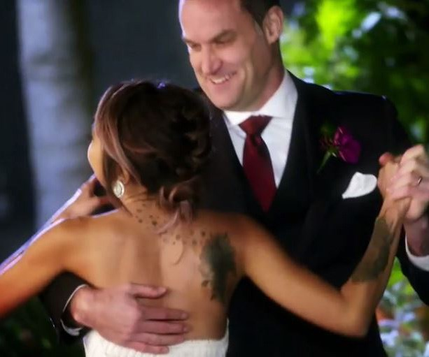 Her beautiful strapless gown showed off all of her tattoos. *(Image: Channel Nine)*