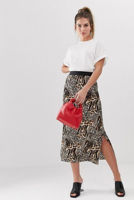 A plain white tee goes down a treat with a printed midi-skirt. *(Image: The Iconic)*