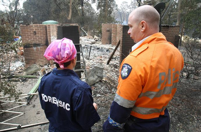 Police oversee a house destroyed in Kinglake, Victoria. *(Image: Getty)*
