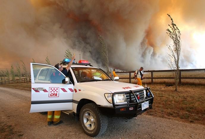 CFA members monitor a raging fire near Labertouche, Victoria. *(Image: Getty)*