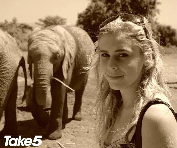 On a trip to Kenya - she really caught the travel bug.