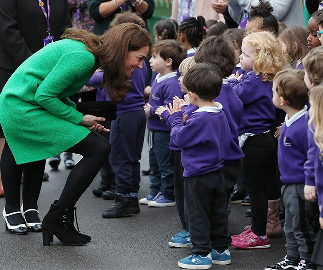 The duchess doesn't just use the technique with her own children. You'll see her kneeling down to talk all children she greets. *(Image: Getty)*