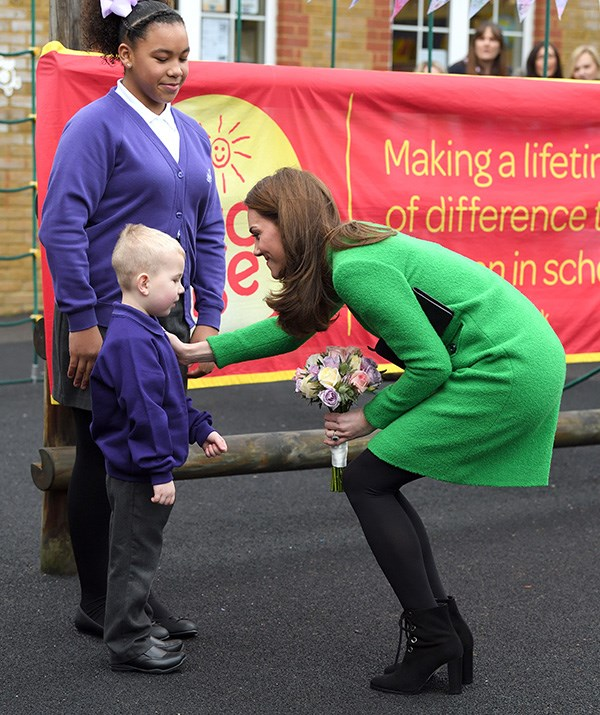 The royal is a natural with kids. *(Image: Getty)*
