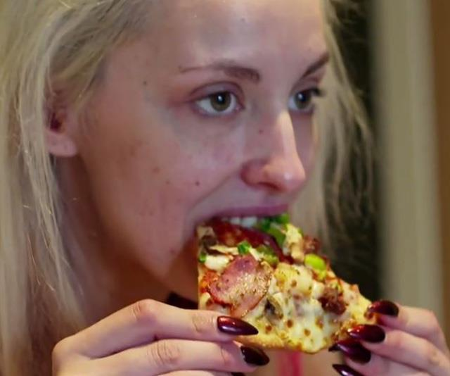 Wait, what did she just do with that slice of pizza!? *(Image: Nine)*