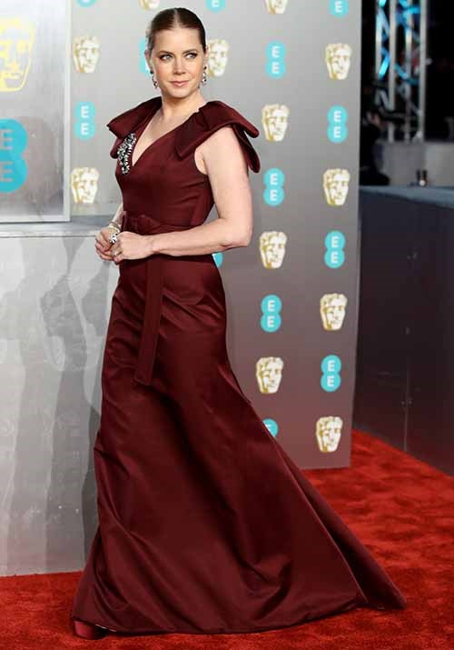 Amy Adams' maroon gown and slicked back look oozed class. *(Image: Getty)*