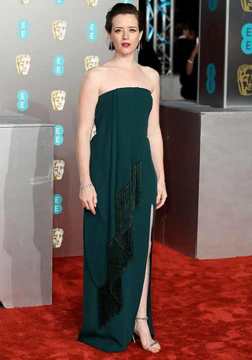 *The Crown* actress Claire Foy looked classy and elegant in a moss green gown with tassel detailing. *(Image: Getty)*
